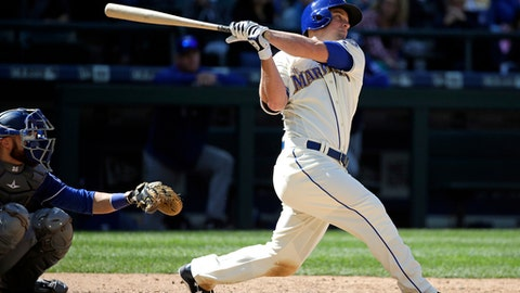 Seattle Mariners' Kyle Seager, right, and Texas Rangers catcher Jonathan Lucroy watch the path of Seager's solo home run in the eighth inning of a baseball game Sunday, May 7, 2017, in Seattle. (AP Photo/Elaine Thompson)