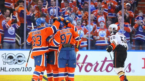 Anaheim Ducks' Antoine Vermette (50) skates past as the Edmonton Oilers celebrate a goal during the first period in Game 6 of a second-round NHL hockey playoff series in Edmonton, Alberta, Sunday, May 7, 2017. (Jason Franson/The Canadian Press via AP)
