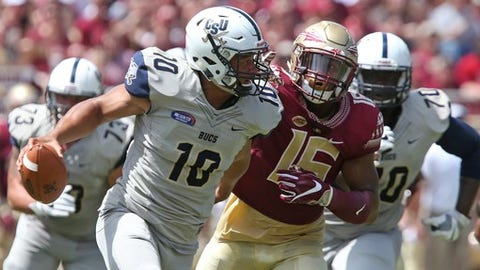 Charleston Southern's Robert Mitchell scrambles for yardage as he is pursued by Florida State's Carlos Becker in the first half of an NCAA college football game, Saturday, Sept. 10, 2016, in Tallahassee, Fla. Florida State won the game 52-8. (AP Photo/Steve Cannon)