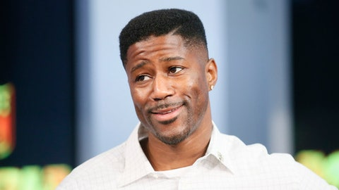 "FILE - In this Sept. 9, 2015, file photo, former NFL player Nate Burleson is interviewed during a media availability on set at the at NFL Network studios in Culver City, California. CBS is making another change to its cast for the ""NFL Today"" show on Sundays, adding Nate Burleson to replace Bart Scott. Burleson is the second newcomer to the program, although Phil Simms is moving from the broadcast booth to the studio. That switch was announced last month. (AP Photo/Danny Moloshok, File)"