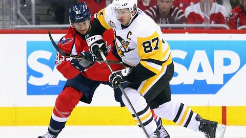 WASHINGTON, DC - MAY 06:  Sidney Crosby #87 of the Pittsburgh Penguins is checked by Jay Beagle #83 of the Washington Capitals  in Game Five of the Eastern Conference Second Round during the 2017 NHL Stanley Cup Playoffs at the Verizon Center on May 6, 2017 in Washington, DC. The Capitals defeated the Penguins 4-2.  (Photo by Bruce Bennett/Getty Images)