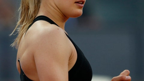 Eugenie Bouchard from Canada celebrates a point against Maria Sharapova from Russia at the end of their Madrid Open tennis tournament match in Madrid, Spain, Monday, May 8, 2017. Bouchard won 7-5, 2-6 and 6-4. (AP Photo/Francisco Seco)