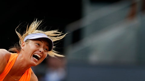 Maria Sharapova from Russia serves against Eugenie Bouchard from Canada during a Madrid Open tennis tournament match in Madrid, Spain, Monday, May 8, 2017. Bouchard won 7-5, 2-6 and 6-4. (AP Photo/Francisco Seco)