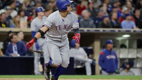 Texas Rangers' Shin-Soo Choo watches his home run hit during the seventh inning of a baseball game against the San Diego Padres Monday, May 8, 2017, in San Diego. (AP Photo/Gregory Bull)
