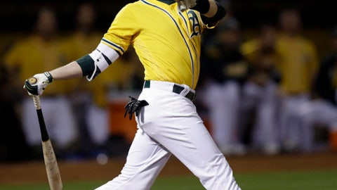Oakland Athletics' Jed Lowrie swings for a walk off home run off Los Angeles Angels' Deolis Guerra in the eleventh inning of a baseball game Monday, May 8, 2017, in Oakland, Calif. (AP Photo/Ben Margot)