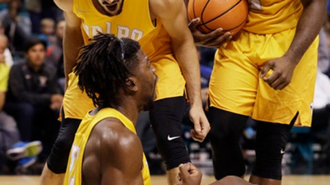 Valparaiso guard Shane Hammink, top left, guard Max Joseph, right, and forward Jubril Adekoya celebrate after a play against BYU during the second half of an NCAA college basketball game Wednesday, Nov. 23, 2016, in Las Vegas. Valparaiso won 92-89. (AP Photo/John Locher)
