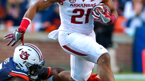 FILE - In this Oct. 22, 2016, file photo, Arkansas running back Devwah Whaley (21) tries to elude the tackle of Auburn linebacker Deshaun Davis (57) during the first half of an NCAA college football game in Auburn, Ala.  Arkansas was expected to have one of the most talented backfields in the Southeastern Conference entering the 2017 season. That depth will now be tested after running back Rawleigh Williams walked away from the game on Monday, May 8, 2017, after his latest injury, leaving sophomore Devwah Whaley as the Razorbacks likely top rushing option. (AP Photo/Butch Dill, File)