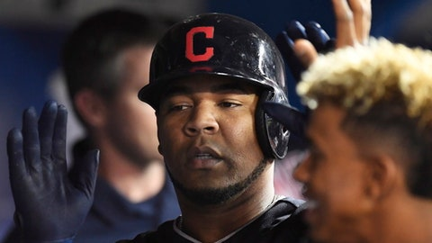 Cleveland Indians designated hitter Edwin Encarnacion is congratulated by teammates after scoring against the Toronto Blue Jays during the second inning of a baseball game Tuesday, May 9, 2017, in Toronto. (Frank Gunn/The Canadian Press via AP)