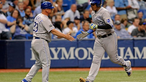 Kansas City Royals third base coach Mike Jirschele congratulates Salvador Perez, right after his two-run homer off Tampa Bay Rays starter Matt Andriese during the sixth inning of a baseball game, Tuesday, May 9, 2017, in St. Petersburg, Fla. (AP Photo/Steve Nesius)