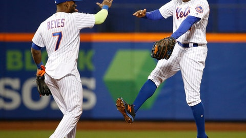 New York Mets shortstop Jose Reyes (7) and center fielder Curtis Granderson celebrate after the Mets defeated the San Francisco Giants 6-1 in a baseball game, Tuesday, May 9, 2017, in New York. (AP Photo/Kathy Willens)
