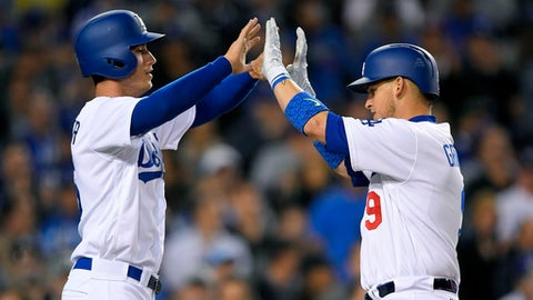 Los Angeles Dodgers' Yasmani Grandal, right, is congratulated by Cody Bellinger after hitting a two-run home run during the fourth inning of the team's baseball game against the Pittsburgh Pirates, Tuesday, May 9, 2017, in Los Angeles. (AP Photo/Mark J. Terrill)