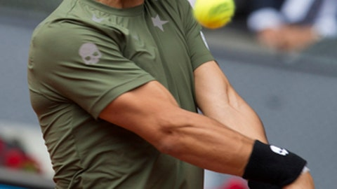 Fabio Fognini of Italy eyes the ball during a Madrid Open tennis tournament match against Rafael Nadal of Spain in Madrid, Wednesday, May 10, 2017. (AP Photo/Paul White)