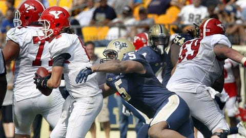 Pittsburgh defensive lineman Ejuan Price (5) sacks Youngstown State quarterback Hunter Wells (6) in the third quarter of an NCAA football game, Saturday, Sept. 5, 2015, in Pittsburgh. Pittsburgh won 45-37. (AP Photo/Keith Srakocic)