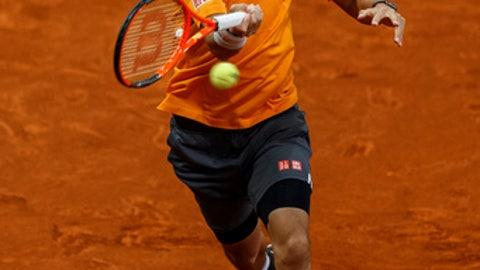 Kei Nishikori of Japan returns the ball to David Ferrer of Spain during a Madrid Open tennis tournament match in Madrid, Thursday, May 11, 2017. (AP Photo/Daniel Ochoa de Olza)