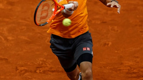 Kei Nishikori of Japan returns the ball to David Ferrer of Spain during a Madrid Open tennis tournament match in Madrid, Thursday, May 11, 2017. (AP Photo/Daniel Ochoa de Olza)