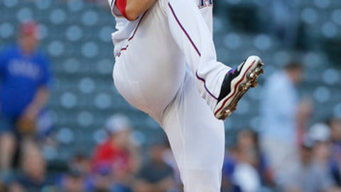 Texas Rangers pitcher Martin Perez winds up during the first inning of the team's baseball game against the San Diego Padres, Thursday, May 11, 2017, in Arlington, Texas. (AP Photo/Tony Gutierrez)