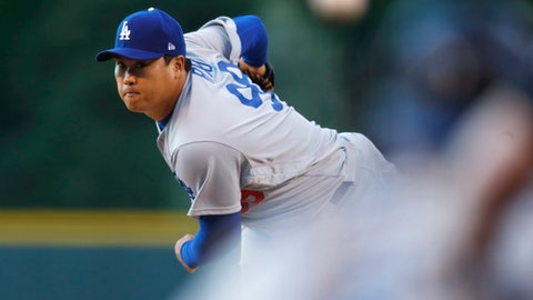 Los Angeles Dodgers starting pitcher Hyun-Jin Ryu watches a throws to a Colorado Rockies batter during the first inning of a baseball game Thursday, May 11, 2017, in Denver. (AP Photo/David Zalubowski)