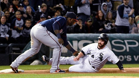 Minnesota Twins third baseman Miguel Sano, left, tags out Chicago White Sox's Matt Davidson (24) at third base during the fourth inning of a baseball game, Thursday, May 11, 2017, in Chicago. (AP Photo/David Banks)