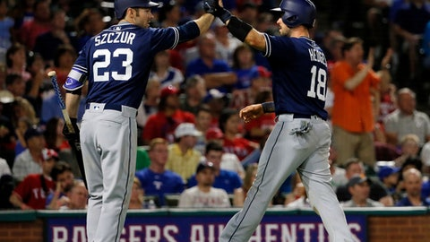 San Diego Padres' Matt Szczur (23) and Austin Hedges, right, celebrate after Hedges scored on a sacrifice fly by Manuel Margot during the seventh inning of the team's baseball game against the Texas Rangers on Thursday, May 11, 2017, in Arlington, Texas. (AP Photo/Tony Gutierrez)