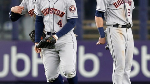 Houston Astros left fielder Jake Marisnick, center fielder George Springer (4) and right fielder Josh Reddick, from left, celebrate after the Astros defeated the New York Yankees 3-2 in a baseball game in New York, Thursday, May 11, 2017. Marisnick threw from left field on Gary Sanchez's RBI single, and catcher Brian McCann tagged out Jacoby Ellsbury for the final out. (AP Photo/Kathy Willens)