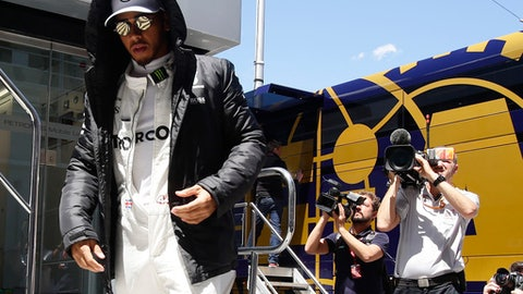 Mercedes driver Lewis Hamilton of Britain walks in the paddock prior to the start of the second practice session for the Spanish Formula One Grand Prix at the Barcelona Catalunya racetrack in Montmelo, Spain, Friday, May 12, 2017. The F1 race will be held on Sunday. (AP Photo/Manu Fernandez)