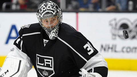 Los Angeles Kings goalie Ben Bishop watches the puck after defecting it during the third period of the team's NHL hockey game against the Winnipeg Jets, Thursday, March 23, 2017, in Los Angeles. The Kings won 5-2. (AP Photo/Mark J. Terrill)