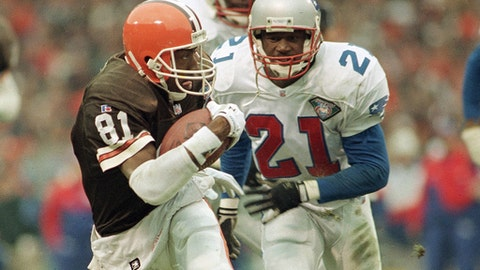 FILE - In this Jan, 1, 1995, file photo, Cleveland Browns' wide receiver Michael Jackson (81) runs away from New England Patriots cornerback Ricky Reynolds (21) with an 18-yard pass reception in the second quarter of the AFC playoff NFL football game in Cleveland. An early morning accident Friday, May 12, 2017, has claimed the lives of two people, including former NFL player Michael Jackson who, after retiring from football, also served as mayor of a Louisiana village. (AP Photo/Jeff Glidden, File)