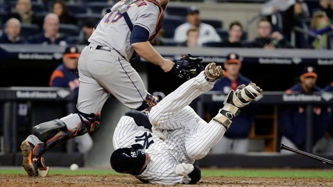 New York Yankees' Chase Headley falls down during his at-bat after attempting to bunt as Houston Astros catcher Brian McCann scrambles for the ball during the seventh inning of a baseball game Friday, May 12, 2017, in New York. (AP Photo/Frank Franklin II)