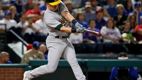 Oakland Athletics' Mark Canha connects on an RBI pinch-hit double off Texas Rangers' Jeremy Jeffress during the seventh inning of a baseball game, Friday, May 12, 2017, in Arlington, Texas. The hit scored Trevor Plouffe. (AP Photo/Tony Gutierrez)