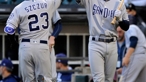 San Diego Padres' Matt Szczur (23) celebrates with teammate Cory Spangenberg right, after hitting a solo home run during the first inning of an interleague baseball game against the Chicago White Sox, Friday, May 12, 2017, in Chicago. (AP Photo/Paul Beaty)