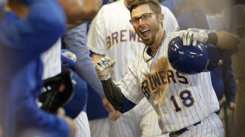 Milwaukee Brewers' Eric Sogard celebrates his two-run home run with teammates during the sixth inning of a baseball game against the New York Mets Friday, May 12, 2017, in Milwaukee. (AP Photo/Morry Gash)