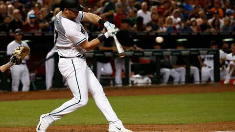 Arizona Diamondbacks' Brandon Drury connects for a two-run home run against the Pittsburgh Pirates during the third inning of a baseball game Friday, May 12, 2017, in Phoenix. (AP Photo/Ross D. Franklin)