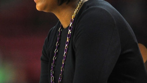 Charleston's head coach Natasha Adair directs her team in the first half of an NCAA basketball game against Maryland Sunday, Dec. 29, 2013 in College Park, Md. Maryland won 103-51.(AP Photo/Gail Burton)