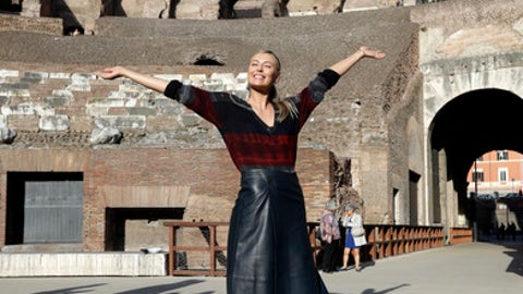 Russia's Maria Sharapova poses during an exhibition at the Rome ancient Colosseum ahead of the Italian Open tennis tournament, Sunday, May 14, 2017. (AP Photo/Gregorio Borgia)