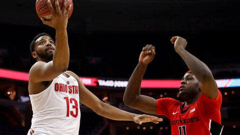 Ohio State guard JaQuan Lyle (13) shoots in front of Rutgers forward Eugene Omoruyi (11) during the second half of an NCAA college basketball game in the Big Ten tournament, Wednesday, March 8, 2017, in Washington. Rutgers won 66-57. (AP Photo/Alex Brandon)