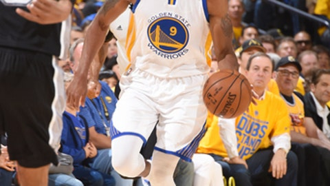 OAKLAND, CA - MAY 14: Andre Iguodala #9 of the Golden State Warriors handles the ball against the San Antonio Spurs in Game One of the Western Conference Finals of the 2017 NBA Playoffs on May 14, 2017 at ORACLE Arena in Oakland, California. NOTE TO USER: User expressly acknowledges and agrees that, by downloading and/or using this Photograph, user is consenting to the terms and conditions of the Getty Images License Agreement. Mandatory Copyright Notice: Copyright 2017 NBAE (Photo by Andrew D. Bernstein/NBAE via Getty Images)