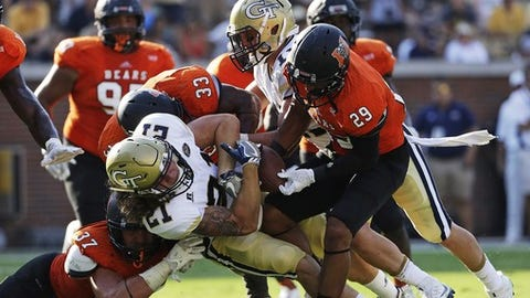 Mercer's Brandon Gurley, right, strips the ball from the grip of Georgia Tech's Quaide Weimerskirch for a fumble in the second half of an NCAA college football game in Atlanta, Saturday, Sept. 10, 2016. (AP Photo/David Goldman)