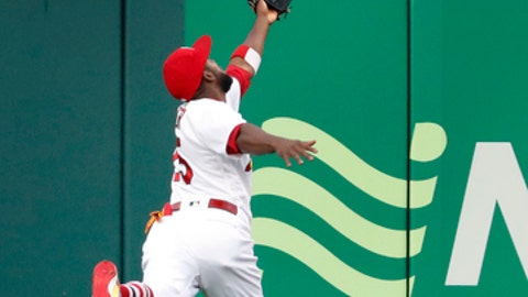 St. Louis Cardinals center fielder Dexter Fowler is unable to catch a triple by Boston Red Sox's Xander Bogaerts during the first inning of a baseball game Wednesday, May 17, 2017, in St. Louis. (AP Photo/Jeff Roberson)