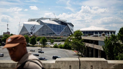 Mercedes-Benz Stadium, the new stadium for the Atlanta Falcons NFL football team, sits under construction at left next to the team's current stadium, the Georgia Dome, in Atlanta, Wednesday, May 17, 2017. Several high-profile failures have plagued Atlanta's reputation on a national stage over the years: transportation woes during the 1996 Olympics, unpreparedness for ice and snow storms, a recent highway collapse and subsequent shutdown from a fire. Now, the city's new $1.5 billion stadium, touted as a state-of-the-art facility that can help transform downtown, is facing construction setbacks with its key feature, a retractable roof that will open and close like a camera lens. (AP Photo/David Goldman)