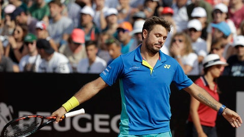 Switzerland's Stan Wawrinka reacts after losing a point during his match against John Isner, of the U.S. at the Italian Open tennis tournament, in Rome, Thursday, May 18, 2017. (AP Photo/Gregorio Borgia)