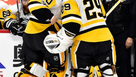 OTTAWA, ON - MAY 17:  Marc-Andre Fleury #29 of the Pittsburgh Penguins skates to the bench as he talks to his replacement Matt Murray #30 of the Pittsburgh Penguins after giving up four goal during the first period to the Ottawa Senators in Game Three of the Eastern Conference Final during the 2017 NHL Stanley Cup Playoffs at Canadian Tire Centre on May 17, 2017 in Ottawa, Canada.  (Photo by Minas Panagiotakis/Getty Images)