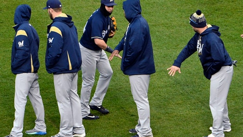 The Milwaukee Brewers celebrate their win against the Chicago Cubs in a baseball game, Friday, May, 19, 2017, in Chicago. (AP Photo/David Banks)