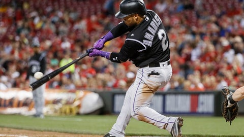 Colorado Rockies' Alexi Amarista connects for a three-run home run off Cincinnati Reds starting pitcher Lisalverto Bonilla during the sixth inning of a baseball game, Friday, May 19, 2017, in Cincinnati. (AP Photo/John Minchillo)
