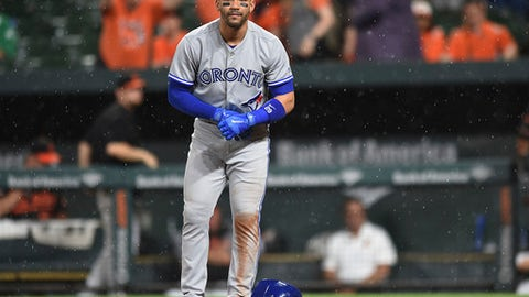Toronto Blue Jays' Devon Travis reacts after striking out in the rain against the Baltimore Orioles during the 10th inning of a baseball game, Friday, May 19, 2017, in Baltimore. (AP Photo/Gail Burton)