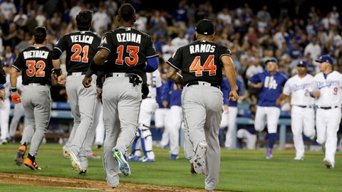 The benches empty during the eighth inning after Miami Marlins' Giancarlo Stanton was almost hit by a Los Angeles Dodgers pitch, at a baseball game in Los Angeles, Friday, May 19, 2017. (AP Photo/Chris Carlson)