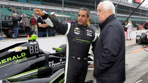 Juan Pablo Montoya, of Colombia, talks with car owner Roger Penske before the start of qualifications for the Indianapolis 500 IndyCar auto race at Indianapolis Motor Speedway, Saturday, May 20, 2017, in Indianapolis. Rain delayed the start of qualifications. (AP Photo/Michael Conroy)