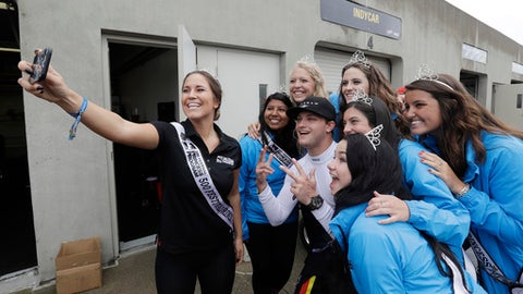 Sage Karam poses with the 500 Festival Princess Program Princesses during a rain delay before qualifications for the Indianapolis 500 IndyCar auto race at Indianapolis Motor Speedway, Saturday, May 20, 2017 in Indianapolis. (AP Photo/Darron Cummings)