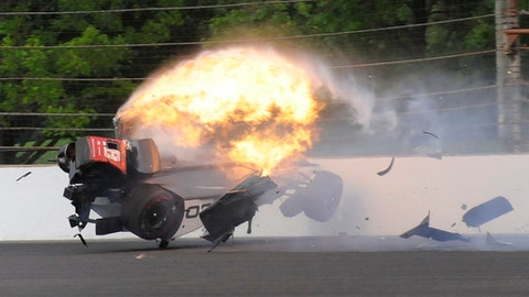 The car driven by Sebastien Bourdais, of France, impacts the wall bursts into flames in the second turn during qualifications for the Indianapolis 500 IndyCar auto race at Indianapolis Motor Speedway, Saturday, May 20, 2017 in Indianapolis. (AP Photo/Greg Huey)
