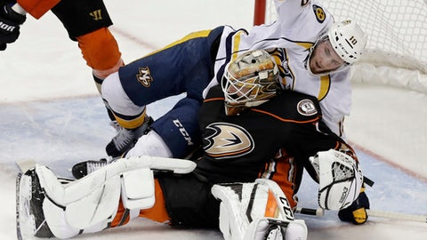 Nashville Predators center Colton Sissons falls onto Anaheim Ducks goalie Jonathan Bernier during the second period of Game 5 in the NHL hockey Stanley Cup Western Conference finals in Anaheim, Calif., Saturday, May 20, 2017. (AP Photo/Chris Carlson)