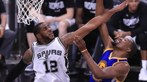 SAN ANTONIO, TX - MAY 20:  Kevin Durant #35 of the Golden State Warriors shoots the ball against LaMarcus Aldridge #12 of the San Antonio Spurs in the second half during Game Three of the 2017 NBA Western Conference Finals at AT&T Center on May 20, 2017 in San Antonio, Texas. NOTE TO USER: User expressly acknowledges and agrees that, by downloading and or using this photograph, User is consenting to the terms and conditions of the Getty Images License Agreement.  (Photo by Ronald Martinez/Getty Images)